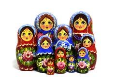 Lot of traditional Russian matryoshka dolls on white. Background Stock Photos