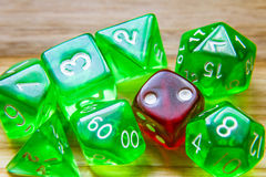 A lot of translucent green playing dice on a wooden background w Royalty Free Stock Photos