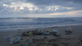 A lot of trash and plastic wastes on ocean beach after the storm. Kuta, Bali, Indonesia. Trash and plastic wastes on ocean beach after the storm. Kuta, Bali stock video