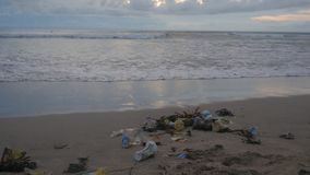 A lot of trash and plastic wastes on ocean beach after the storm. Kuta, Bali, Indonesia.