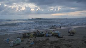 A lot of trash and plastic wastes on ocean beach after the storm. Kuta, Bali, Indonesia. Trash and plastic wastes on ocean beach after the storm. Kuta, Bali stock footage
