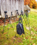 Lot of tripods without cameras are waiting for the shooting. A lot of tripods without cameras are waiting for the shooting Stock Photos
