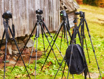 Lot of tripods without cameras are waiting for the shooting. A lot of tripods without cameras are waiting for the shooting Royalty Free Stock Image