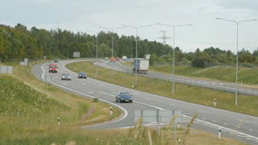 A lot of trucks and cars move on road stock video footage