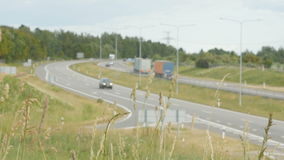 A lot of trucks and cars move on road. Lithuania, the highway Kaunas - Klaipeda. Road section on the settlement of Babtai. A lot of trucks and cars move on road stock footage