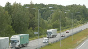 A lot of trucks and cars move on road. 2016 06 11 Lithuania, the highway Kaunas - Klaipeda. Road section on the settlement of Babtai. A lot of trucks and cars stock video footage