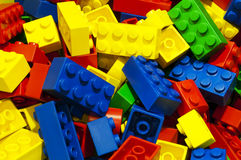 A lot of unsorted colored bricks Stock Photography