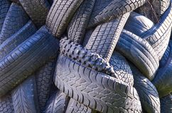 A lot of used car and truck tires background Royalty Free Stock Photo
