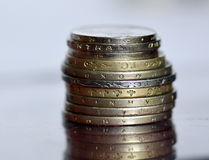 Lot of valuable coins on a glass surface Royalty Free Stock Photography