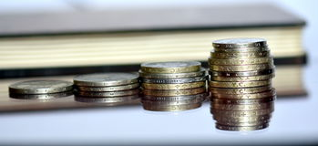 Lot of valuable coins on a glass surface Royalty Free Stock Photos