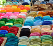 A lot of varicolored spools of thread outdoor. Many bobbins of motley acrylic textile fibers are gathered together Royalty Free Stock Photos