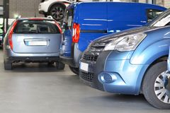 Vehicles in a car workshop for service and repair stock image