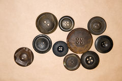 A lot of vintage  buttons  on the craft paper Royalty Free Stock Photos
