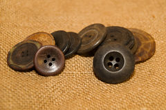 A lot of vintage buttons on old cloth Stock Images