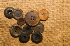 A lot of vintage buttons on old cloth Royalty Free Stock Photo