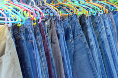 A lot vintage jeans with seams for sale Royalty Free Stock Photos