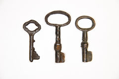 A lot vintage keys from the locks on a white background. Some vintage keys from the locks on a white background royalty free stock image