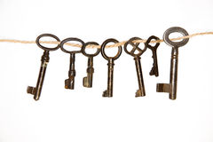 A lot vintage keys from the locks on a white background. Some vintage keys from the locks on a white background royalty free stock photos