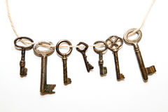 A lot vintage keys from the locks on a white background. Some vintage keys from the locks on a white background royalty free stock photo