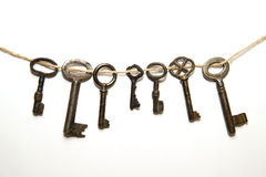 A lot vintage keys from the locks on a white background. Some vintage keys from the locks on a white background stock images
