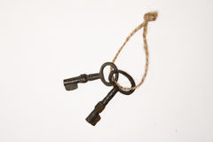 A lot vintage keys on a rope on a white background. Some vintage keys on a rope on a white background stock photography