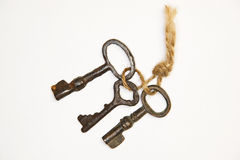 A lot vintage keys on a rope on a white background. Some vintage keys on a rope on a white background stock images