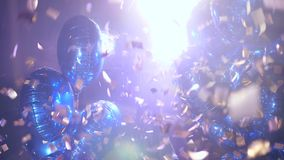 Lot vivid inflatable balls in flying confetti in bright spotlight. Close-up stock video footage