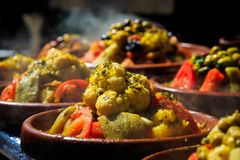 A lot of warm tagines with delicious vegetables on a market Royalty Free Stock Images