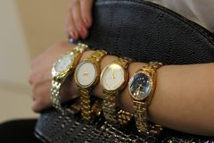 A lot of watches the girl has on her hand a gold watch stock photos
