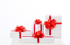 A lot of white gift box with red ribbon bow. Royalty Free Stock Images