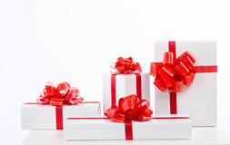 A lot of white gift box with red ribbon bow. Royalty Free Stock Photo