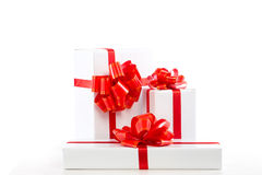 A lot of white gift box with red ribbon bow. Stock Photos