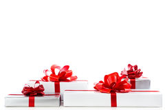 A lot of white gift box with red ribbon bow. Stock Image