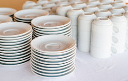 A lot of white plates and coffee cup Stock Image