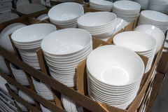 A lot of white plates in the store. This images contains of lot of white plates in the store royalty free stock images