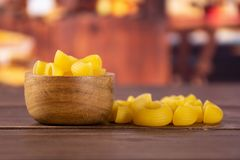 Raw pasta pipe rigate with rustic kitchen stock photos
