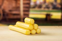 Smoked slovak string cheese stick with cart stock images