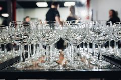 A lot of wine glasses in a row stock images