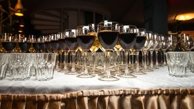 A lot of wineglasses with wine and champagne on the beautiful table. stock images