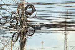 Lot of wire cables messy on electricity pole in the city for saf Royalty Free Stock Images