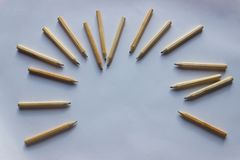 A lot of wooden pencils on a white sheet of paper . Background w. Ith space for text Royalty Free Stock Photography