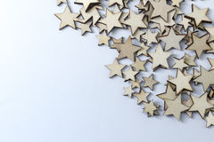 A lot of wooden stars on a white background. Lot of decorative wooden stars on a white background Royalty Free Stock Image