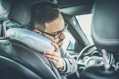 Lot of work breaks a man. Tired business man dreaming in car royalty free stock images