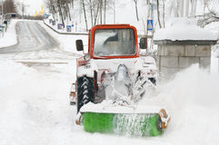 A lot of work after snow blizzard. Snowplow during blizzard, lots of snowy noise Stock Photography