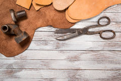 A lot of work tools and leather for shoemaker.Leather craft. Copy space. Stock Photos