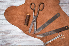 A lot of work tools and leather for shoemaker.Leather craft. Copy space. Royalty Free Stock Image