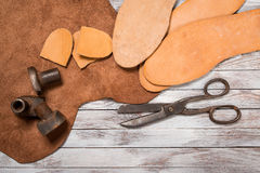 A lot of work tools and leather for shoemaker.Leather craft. Copy space. royalty free stock images