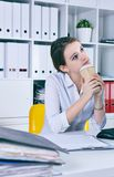 Lot of work wait for dreaming woman with coffe in hans. Dream of a vacation. Lot of work wait for dreaming woman with coffe in hans. Huge pile of document Stock Image