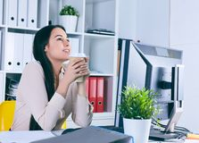 Lot of work wait for dreaming woman with coffe in hans. Dream of a vacation. Lot of work wait for dreaming woman with coffe in hans. Huge pile of document Stock Photography