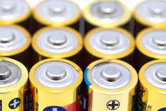 A lot of yellow batteries Royalty Free Stock Images